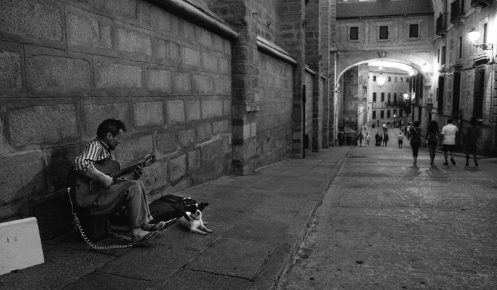 Guitar player and his dog in Toledo